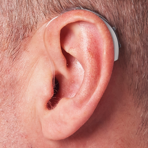 photo-behind-the-ear-artificial-intelligence-hearing-aid-on-ear-paris